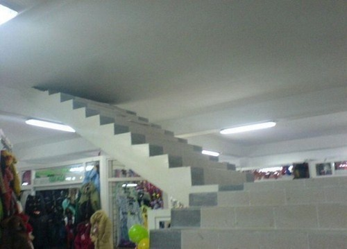 Here is another example of miscommunication in architecture. Materials and time were both wasted in the building of this stair well. Maybe the store had some purpose for the design of this, but this image suggests it was just a mistake.