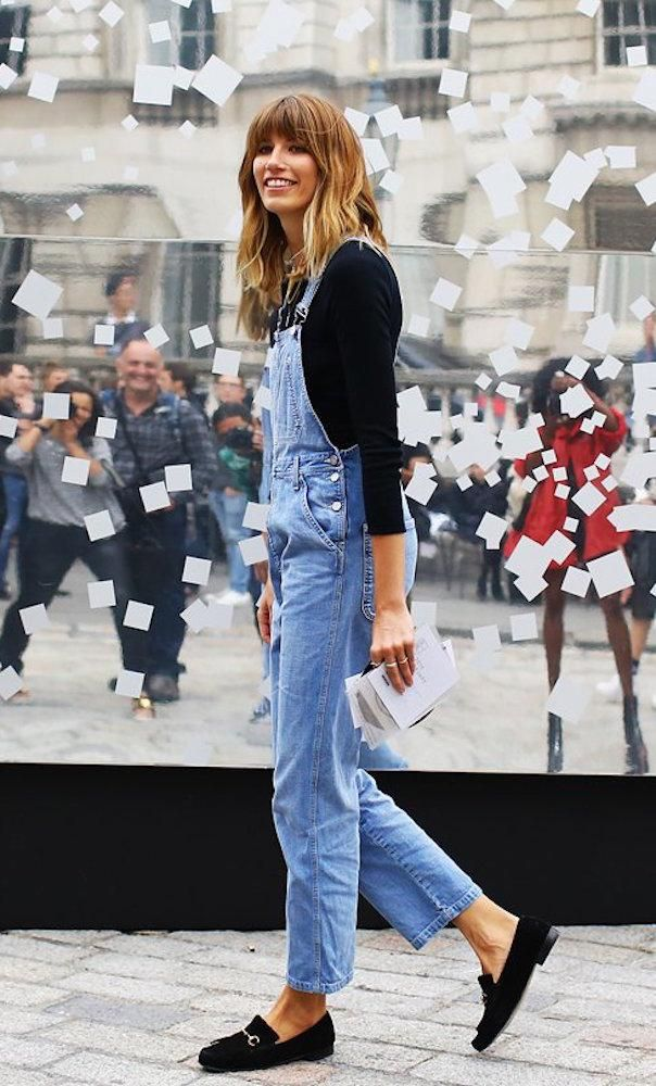 Veronika Heilbrunner in Calvin Klein denim overalls, a black long sleeve and black Gucci shoes