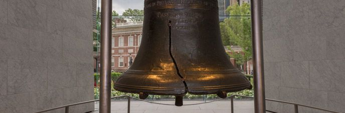 Color photo showing the Liberty Bell, from the shoulder down to the lip, with a focus on the crack.