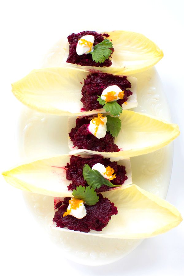 """Beet """"Tartare""""  Earthy roasted beets are brightened by fresh orange zest and tangy balsamic in this clever appetizer, which looks beautiful presented in individual endive spears. To make this dish vegan, omit the Greek yogurt or use a non-dairy yogurt alternative."""