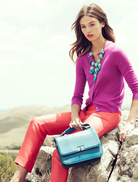 Chic colorblock style in a fandango fuchsia cardigan and coral skinny jeans.  Love the turquoise statement necklace and bag.