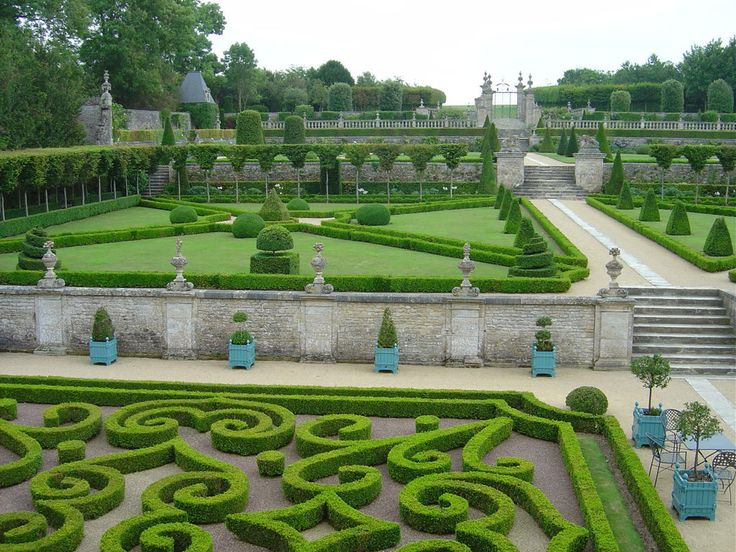 the sculptured gardens at chateau de brecy in normandy france