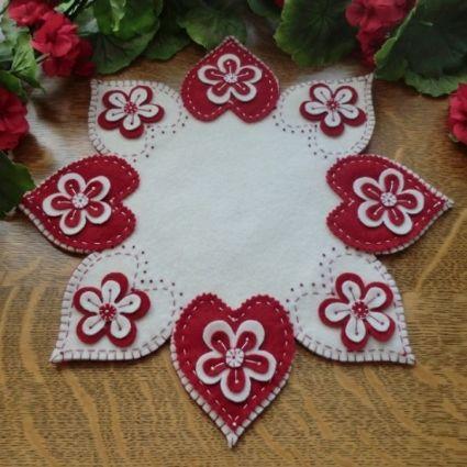 """Valentine Flowers"" Wool Applique Penny Rug Candle Mat Pattern-Valentine Flowers wool applique penny rug candle mat.  Cath's Pennies Designs http://www.cathspenniesdesigns.com"