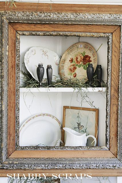 Old Picture Frame...repurposed into a shabby corner wall cupboard.
