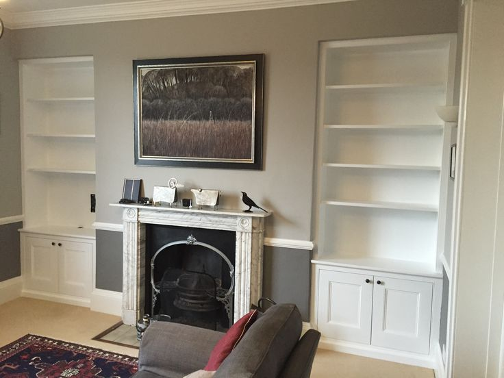 A pair of bespoke fitted alcove unit, traditional dresser style, with book shelves and panelled door cupboards for a living room or dining room. MDF painted in white with light grey walls. Made by Oliver Hazael Bespoke Carpentry and Plastering in Bath, Somerset #alcove #storage #bookshelf #bookshelves #dresser #bespoke #Georgian #Victorian