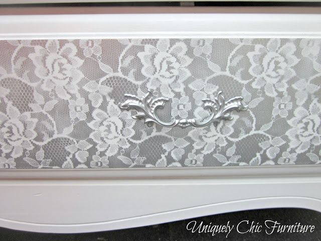 The drawer fronts were done by laying a piece of lace fabric over them and then spray painting. Tape off the edge of the drawers first to keep them white. Make sure to use a fresh piece of lace for each part you spray.