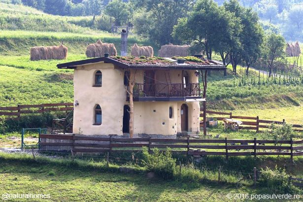 Paul from Romania and Ann, who is Flemish, built this straw bale house together in Sângeorz-Băi, Romania. At first they wanted to buy a traditional wooden house but couldn't find one for sale so they built this. More at www.naturalhomes.org/popasulverde.htm