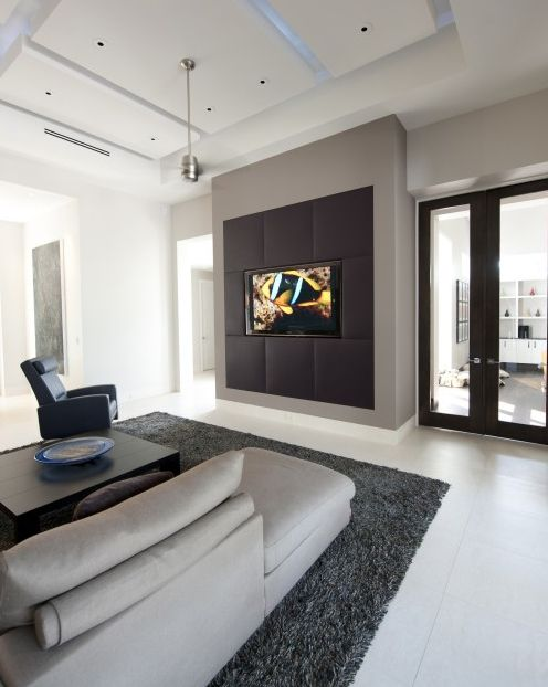 Covered Entertainment Center/Media Wall - It's covered with doors/panels that use black speaker fabric.