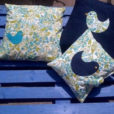 painted pallet and homemade cushions for relaxing in the sun.