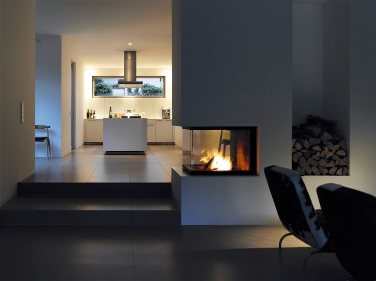 Open fireplace, modern kitchen, dark floors