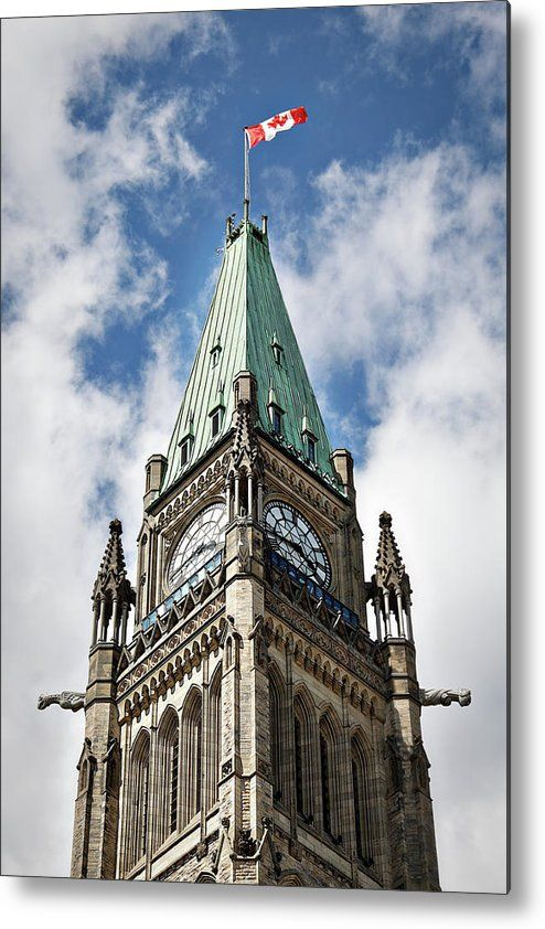 """Clock Tower on the Canadian Parliament building in Ottawa metal print by Tatiana Travelways.   Bring your artwork to life with the stylish lines and added depth of a metal print. Your image gets printed directly onto a sheet of 1/16"""" thick aluminum. The aluminum sheet is offset from the wall by a 3/4"""" thick wooden frame which is attached to the back. The high gloss of the aluminum sheet complements the rich colors of any image to produce stunning results."""