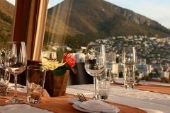 Top of the Ritz: Cape Town: Wedged in between the Atlantic Ocean and towering Table Mountain—with the new World Cup Stadium to the north and posh Camps Bay beaches to the south—this dining room showcases Cape Town's main attractions in one gradual revolution. The menu, meanwhile, covers traditional South Africa fare, dishes like ostrich carpaccio ($7) and a salad of biltong (beef jerky) and goat cheese ($7), plus plenty of wine from the vineyards of nearby Stellenbosch.    Heads Up: Robben…
