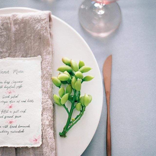 Art de la table ✨ // Hand-written menu, cotton napkin, brushed rose gold flatware, blush goblets and the final & most important touch - fresh flowers! Here we used local pistachio tree branches  . . . #santoriniwedding #santoriniglamweddings #weddingingreece #weddingdesigner #artdelatable  #destinationelopement #privatedining #weddingdetail #weddingdecoration #destinationweddingplanner