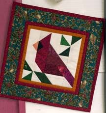 Paper pieced cardinal block. Template included at this site.
