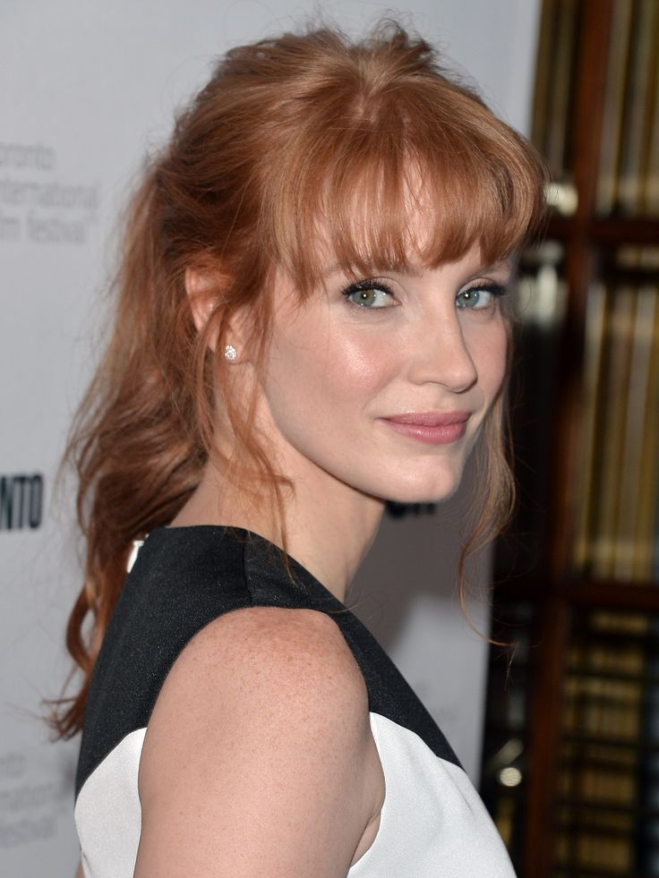"""To give a little bounce to your bangs—especially if you have finer hair—blow-dry using a round brush. """"You don't want a lot of height on the roots, just a bend through the mid-lengths and ends,"""" says Hill. When you're done, set with a blast of cool air. Getty Images - Redbook.com"""