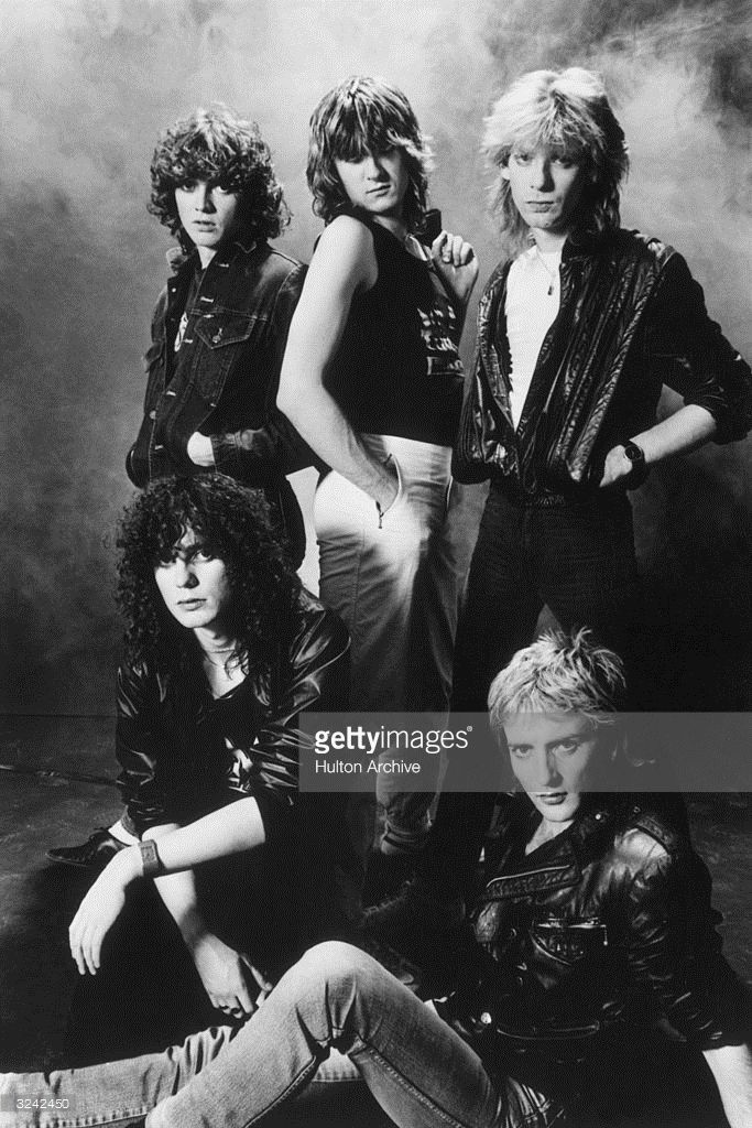 A studio portrait of the British rock group Def Leppard. Clockwise from top left: Bassist Rick Savage, lead singer Joe Elliot, guitarist Steve Clark, guitarist Phil Collen, and drummer Rick Allen.  (Photo by Hulton Archive/Getty Images)