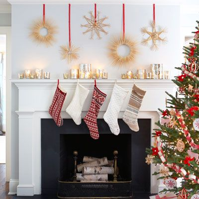 Stocking Feat   A row of no-sweat sweater stockings — stitched up quickly from secondhand cable knits and Fair Isles (follow our online pattern) Wheat wreaths, staggered on the wall above, er, Finnish the look.