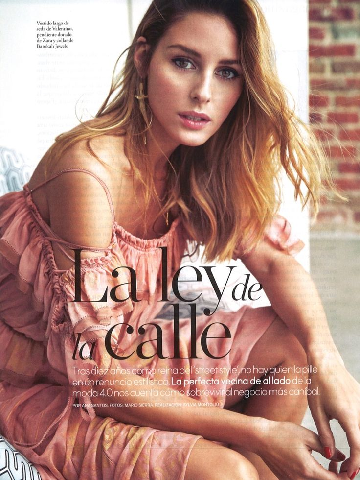 Olivia Palermo poses in Valentino dress with Zara earring