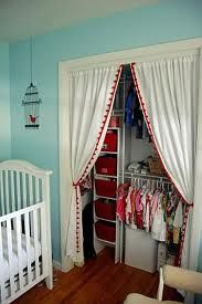 Style of curtain for closet - neutral linen or muslin, with pole hidden at back and 2 metal holdbacks fastened to edges
