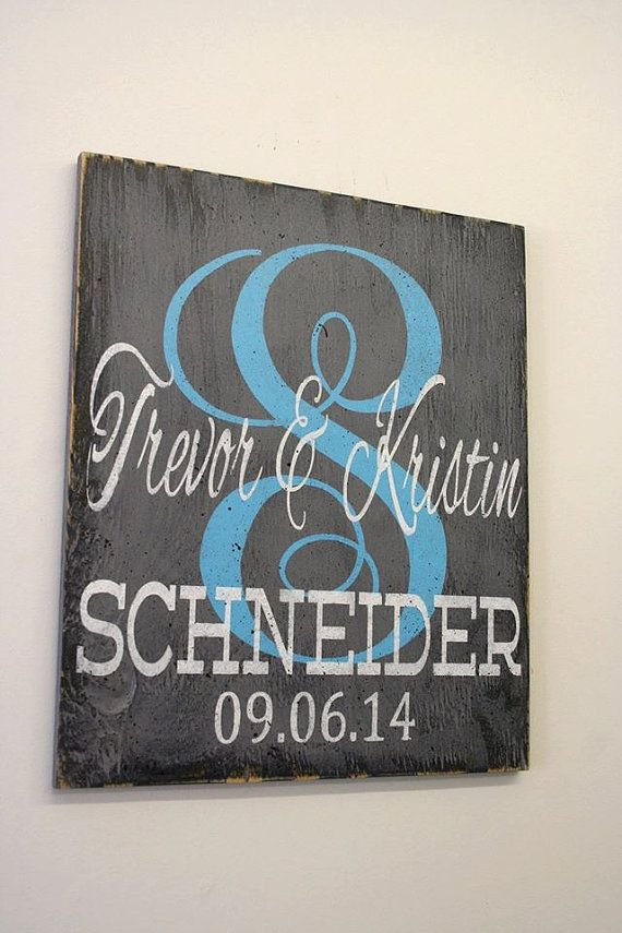 Perfect gift the the new couple! This is a wood sign. The background is painted gray and monogram is Caribbean Blue. Names and date are in