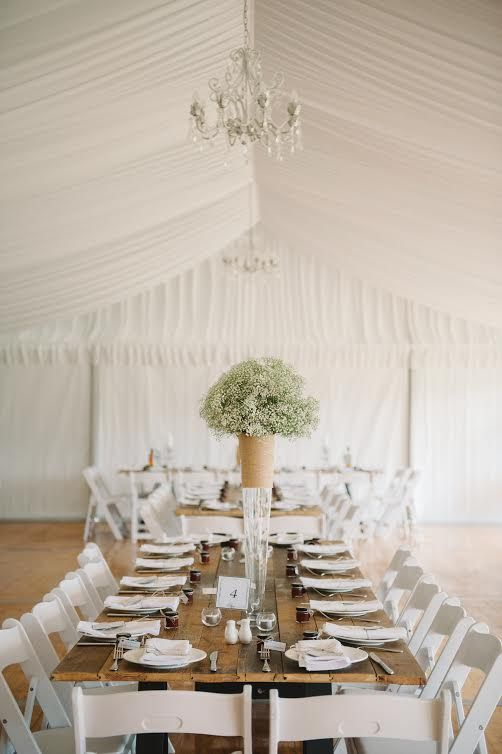 silk lining, chandeliers, 10m marquee structure, integrated timber flooring, integrated timber flooring, vintage timber tables, white padded folding chairs, south coast weddings, south coast party hire