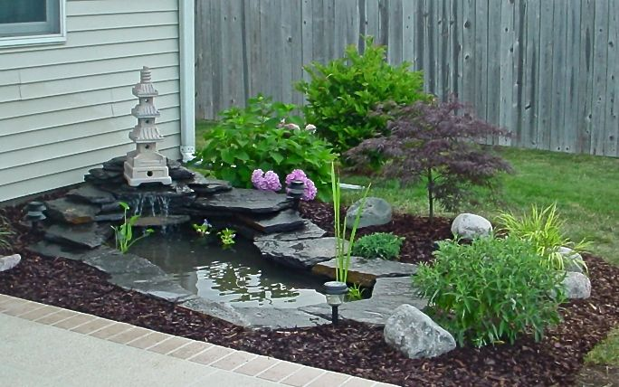 My dream home will have a koi pond or water fixture of some sort, hopefully one I design. I like the xeriscaping around this one--less lawn to water and mow! I'm kinda tired of my big grassy backyard already.