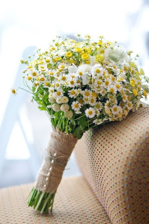 A charming summer wedding look: burlap and wildflowers. With pearl pins, this bouquet becomes an elegant must have for your rustic, garden or outdoor wedding.  http://www.lightsforalloccasions.com/p-3693-burlap-ribbon-15-inches-x-10-yards-rustic-vintage-wedding-burlap.aspx