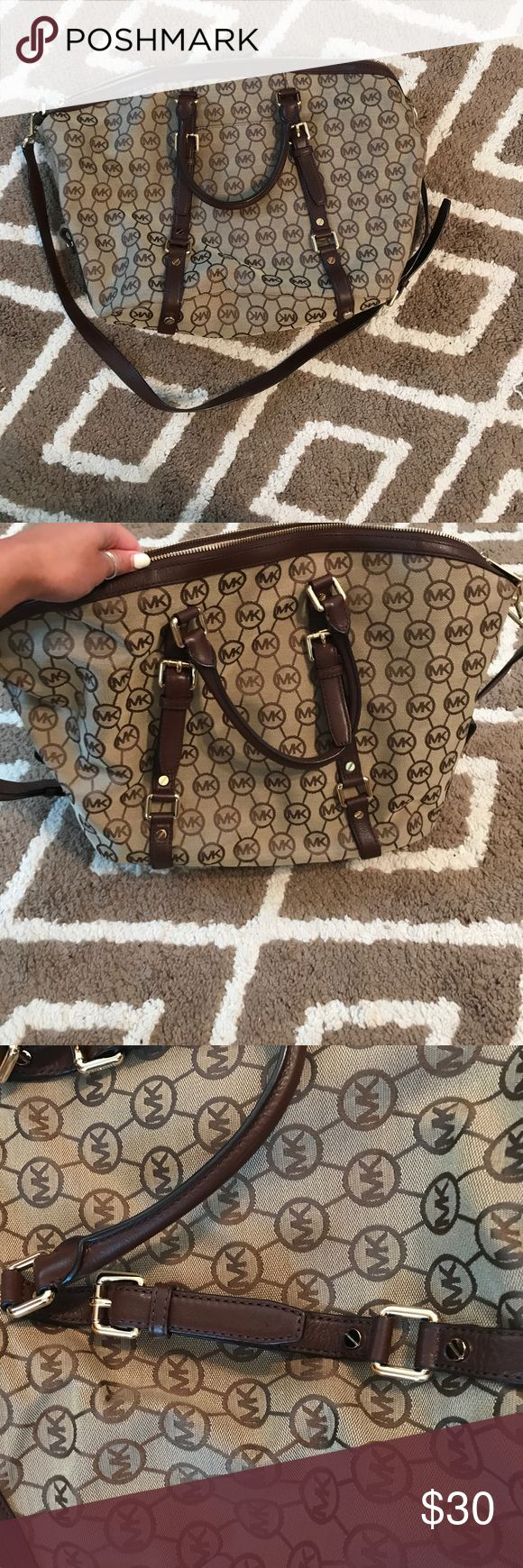 Tan and brown Michael Kors bag Large tan/brown Michael Kors bag. Has long Sholder strap that can be removed. 4 smaller pockets on inside and one bigger zipper pocket. Never used. Excellent condition! Michael Kors Bags