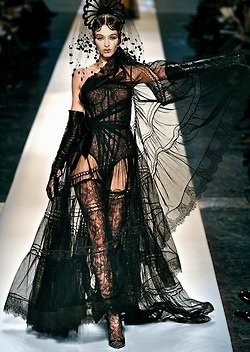 chloes-vintage-nostalgia:    chiffonandribbons:    Jean Paul Gaultier Couture S/S 2009    shes working it!    I can see a big spanish influence here!