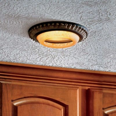Update your run-down-looking white recessed light with a decorative can light cover.