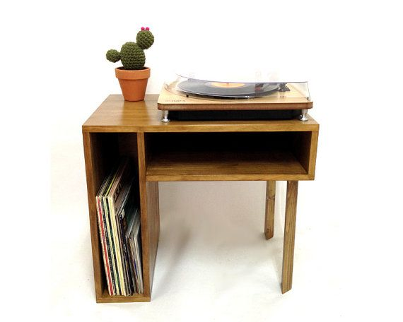 This is a quality solid wood handmade record table / Side table. It is a made to order item. This table has been designed and hand crafted in our workshop using quality solid pine for the body and solid oak angular legs. The table is hand stained in a walnut finish, other finishes or paint colors are required on request.  The design of this table was inspired by mid century Danish minimalist furniture. It would look great in any room as a record table, magazine table or simply as a coffee or…