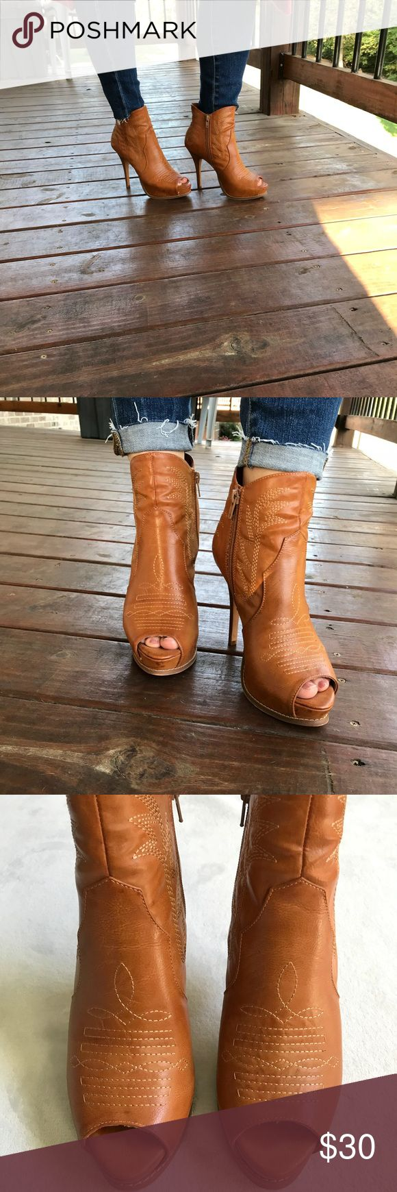 Miranda Lambert Escapade boots Great condition open toe boots. Super cute and they have great support, you don't wobble in these shoes. 5 inch heels. Small discoloration shown in last picture but that's it. Side zipper. Miranda Lambert Shoes Heeled Boots