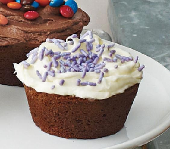 Chocolate Cupcakes With Vanilla Frosting and Sprinkles