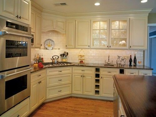 Notice the corner stove top - I would have a peninsula coming out to the right. Nice combo with counters, backsplash, flooring.