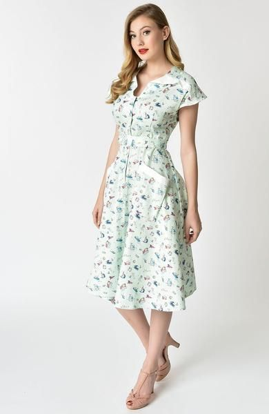 18e549c828679 Steer into the storm with Hedda, dames! Swimming with passion for  mid-century mariner art, The Hedda Dress from Unique Vintage is a seafaring  piece that ...