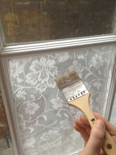 Add lace to your window with cornstarch. Iron your lace and cut to fit. Mix 2 tbsp cornstarch with about an equal amount of cold water, then mix that in about a cup and a half of boiling water.  Paint a thick layer on the window pane. Then apply another thick layer on top using random brush strokes being sure to get all the corners. To remove it, you just wash it off with warm water,
