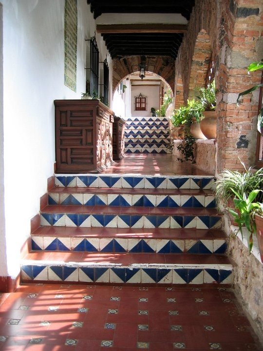 Love tiled stairs! From: http://www.tierrayfuego.com/talavera-mexican-tile-sample-installations.html