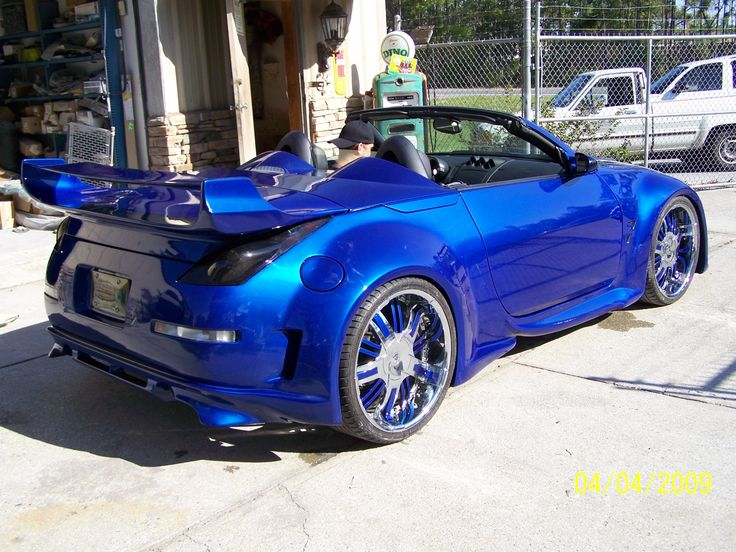 Z car with a wide body kit painted House of Kolors
