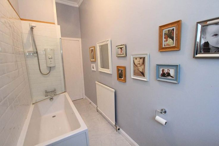 A mis-matched photo gallery in your bathroom is a great way to add a touch of personality to an often forgotten space