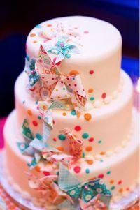 confetti pinwheel wedding cake - what fun! @ Juxtapost.com