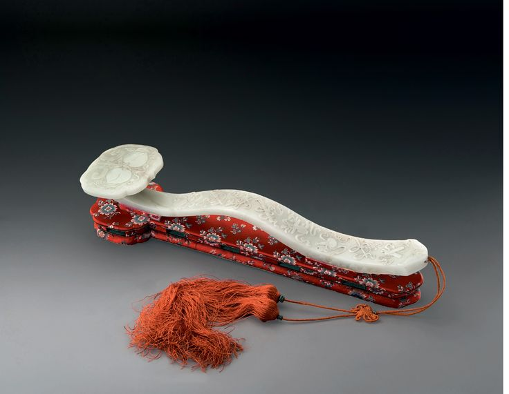 """Ruyi (如意, lit. """"as desired; as  wish) is a curved decorative object that serves as a ceremonial sceptre in Chinese Buddhism or a talisman symbolizing power and good fortune in Chinese folklore. A traditional ruyi has a long S-shaped handle and a head fashioned like a fist, cloud, or lingzhi mushroom. Ruyi are constructed"""