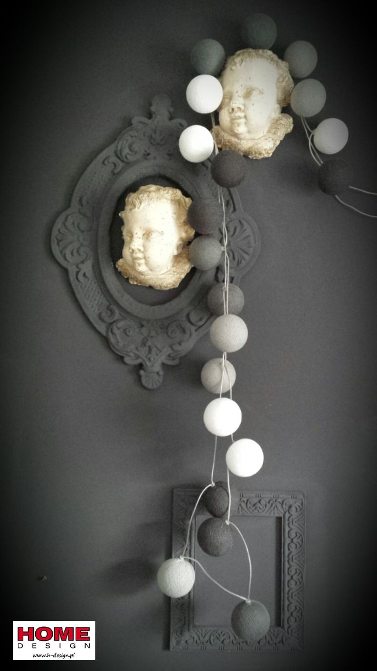 Styling with Grafit set of cotton balls lights with sweet angels and fantastic frames.  Photo Monika Hlawiczka, www.h-design location: Home Design showroom