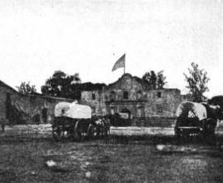 6. San Antonio, 1860s. People in covered wagons arrive at Alamo Plaza.