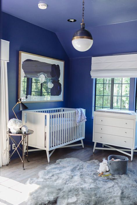 """Tiffani Thiessen and Christiane Lemieux share the story of Tiffani's inspired space for baby Holt. She looks so amazing after having her son... we can only hope to look so great! The nursery is a mix of starry night and lush ski lodge, with a few """"boy"""" toys mixed in (we love the Darth Vader head!)..."""