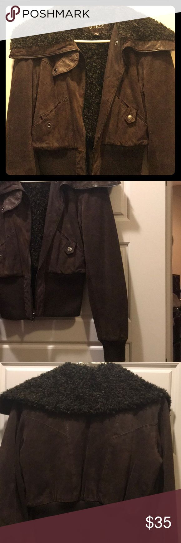 Brown Bomber Jacket Beautiful dark brown suede and fur GUESS bomber jacket! Hardly worn! Fully lined and very warm! Full fur collar through front and back, the suede also has a gorgeous goldfish sheen to it! This jacket hits right at top of hips. Guess Jackets & Coats