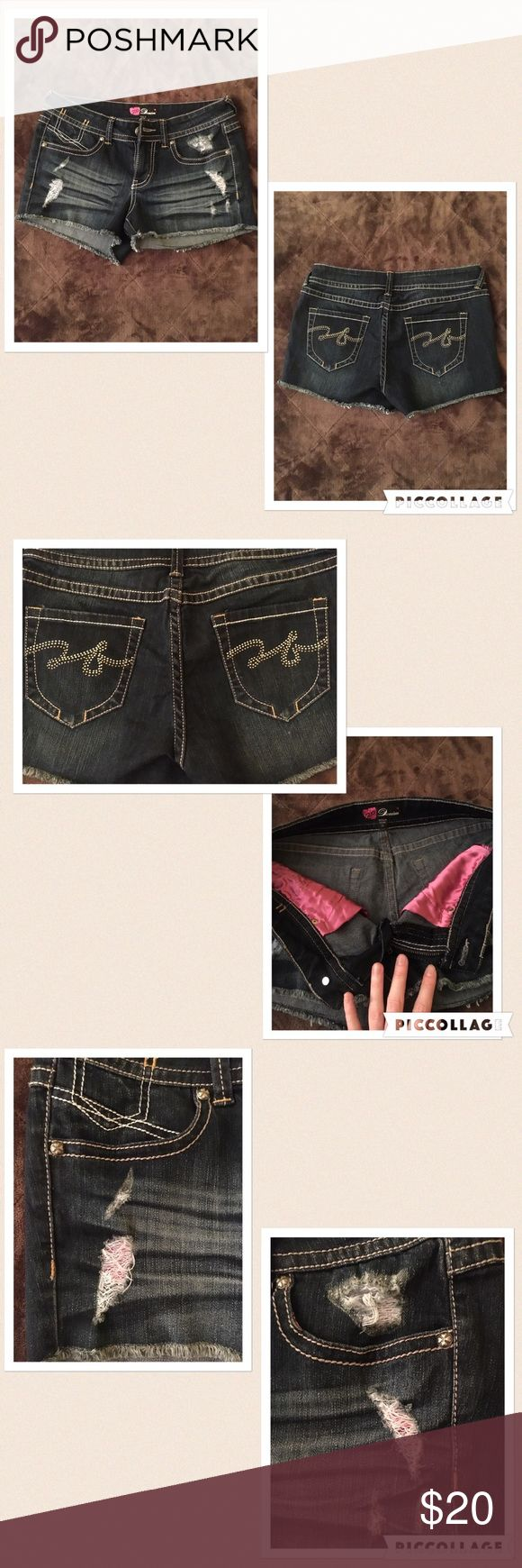 2b Bebe shorts! Adorable shorts! Barely worn destroyed cutoffs. Has pink silky pockets. Only flaws (shown in the last pic) are that on the left pocket there is 1 jewel missing, on the right pocket there's either 2 or 3 jewels missing. I used an arrow to point to where the missing jewels are. It's honestly barely noticeable though!! 2b Bebe Shorts Jean Shorts
