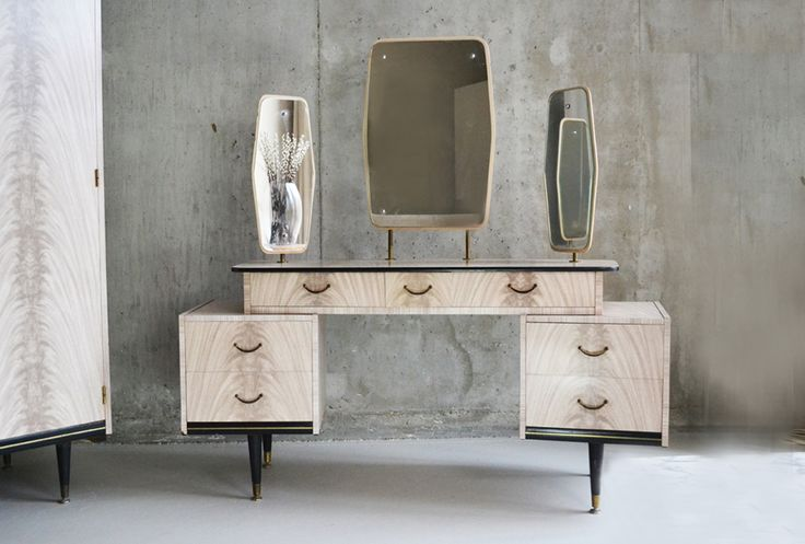 A super 1960's set. A dressing table with 3 adjustable mirrors, and a matching wardrobe, all finished in decorative patterned melamine. Black and brass trime edges the base of both items, with elegant tapered feet. In great condition… a real statement set.   The price listed is for BOTH items.   Designer: Unknown Manufacturer: Berry Furniture Material: Wood, melamine and brass Country of origin: UK Size: Wardrobe: height 174, width 90, depth 56 cm. Dressing table: Overall height 150…
