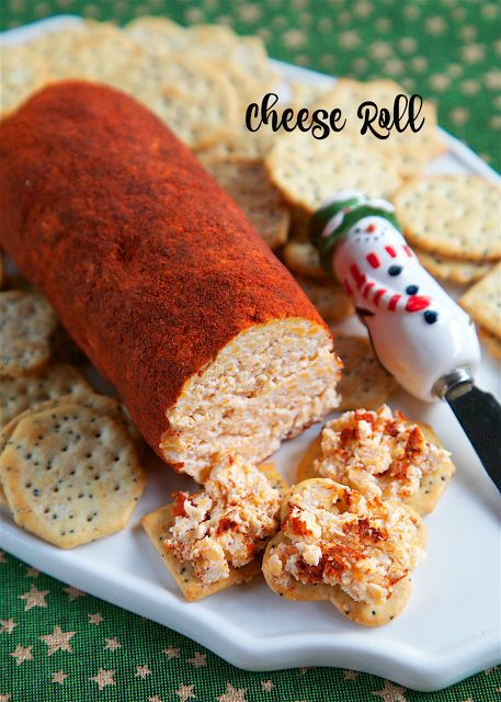 Cheese Roll recipe - cheddar cheese, cream cheese, dry mustard, hot sauce, garlic, mayonnaise and Worcestershire - mix together and roll in a mixture of chili powder and paprika. Great for parties! I am totally addicted to this cheese roll! I could literally eat the whole thing! Serve with crackers.