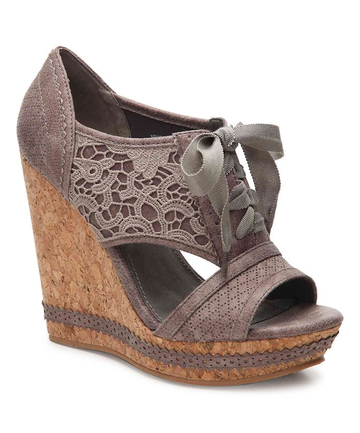 This towering sandal flaunts delicate lace accents and a sturdy wedged heel for daylong comfort.4.25'' heel with 1.75'' platformLace-upMan-madeImported