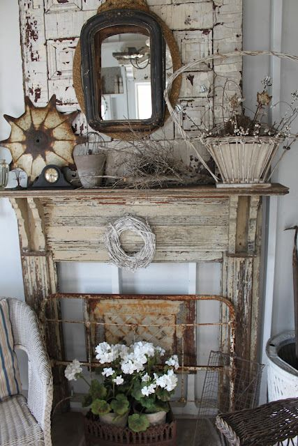 rustic wood mantel and fireplace...love the bed frame in front of the fireplace...